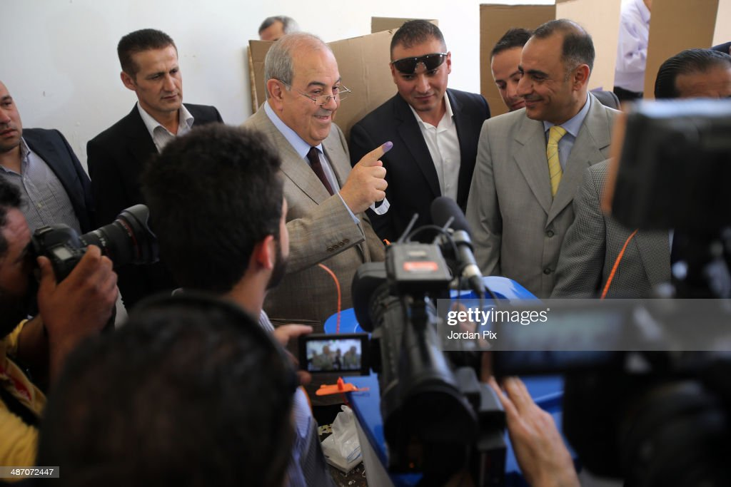 Iraqi politician <a gi-track='captionPersonalityLinkClicked' href=/galleries/search?phrase=Ayad+Allawi&family=editorial&specificpeople=210652 ng-click='$event.stopPropagation()'>Ayad Allawi</a> votes in the Iraqi parliamentary elections at a polling station April 27, 2014 in Amman, Jordan. Iraq's former prime minister <a gi-track='captionPersonalityLinkClicked' href=/galleries/search?phrase=Ayad+Allawi&family=editorial&specificpeople=210652 ng-click='$event.stopPropagation()'>Ayad Allawi</a> on Sunday described the atmosphere as 'unfair' in which his country's current legislative elections take place.