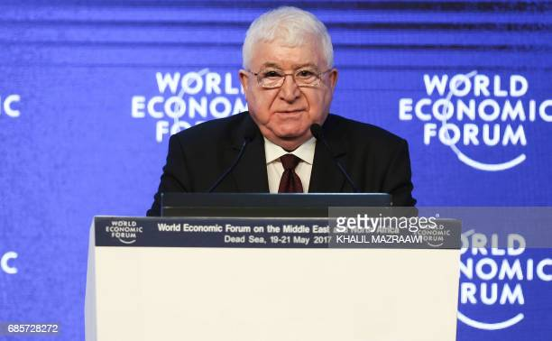 Iraqi President Fuad Masum speaks speaks on the stage during the opening session of the World Economic Forum held in the Dead Sea resort of Shuneh...