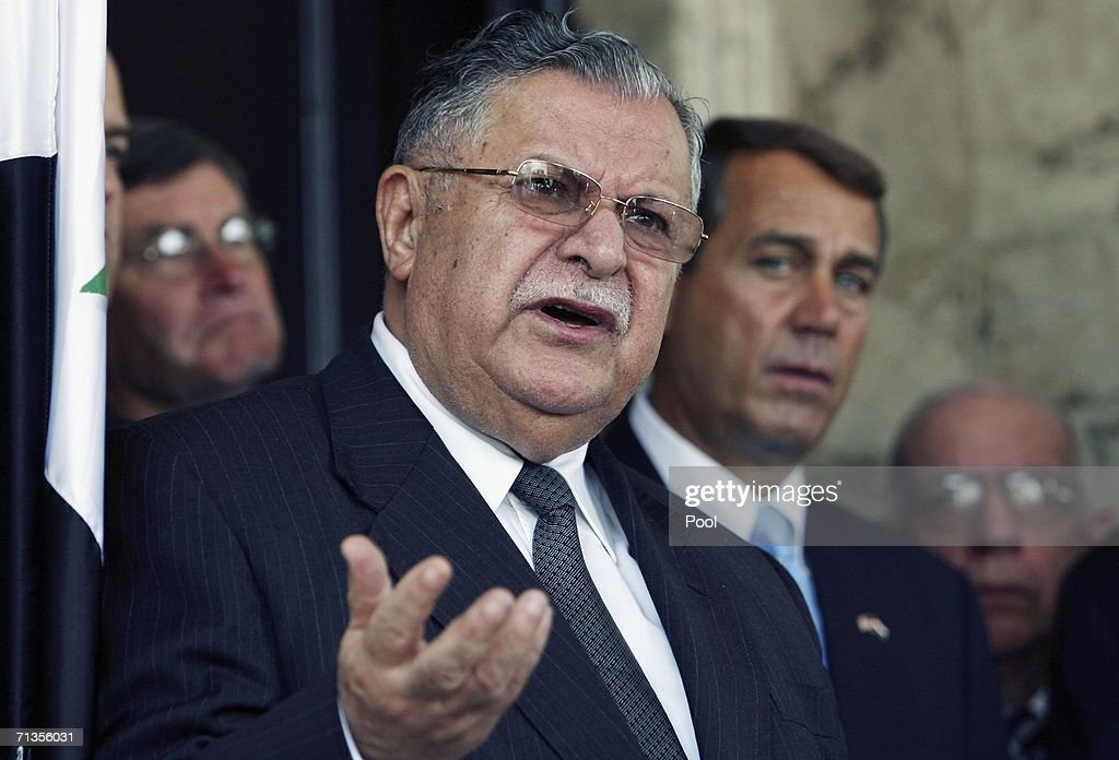 Iraqi President <a gi-track='captionPersonalityLinkClicked' href=/galleries/search?phrase=Jalal+Talabani&family=editorial&specificpeople=213582 ng-click='$event.stopPropagation()'>Jalal Talabani</a> gestures as he speaks during a joint news conference with visiting U.S. Representatives at the fortified Green Zone July 3, 2006 in in Baghdad, Iraq.