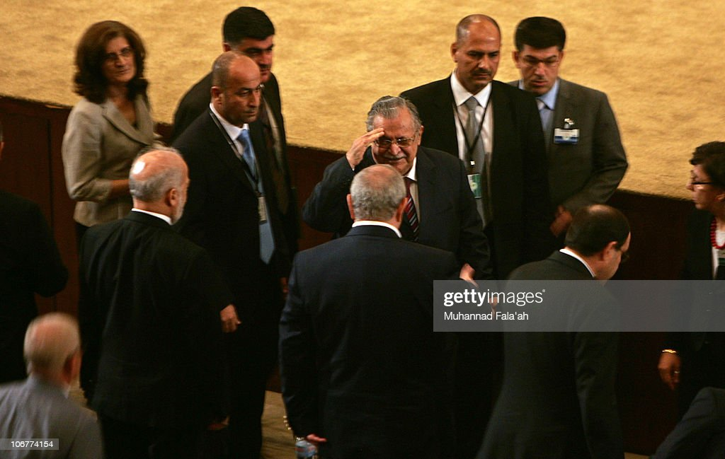 Iraqi President <a gi-track='captionPersonalityLinkClicked' href=/galleries/search?phrase=Jalal+Talabani&family=editorial&specificpeople=213582 ng-click='$event.stopPropagation()'>Jalal Talabani</a> (C) greets Parliament members as he attends a voting session on November 11, 2010 in the Green Zone area in Baghdad, Iraq. Iraqi parliament members met today and managed to elect key leadership positions amid a dispute that led the Sunni-backed Iraqiya bloc to walk out of the chamber.