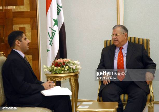 Iraqi President Jalal Talabani meets with Iraqi investigative Judge Raed Juhi 28 July 2005 at the presidential offices in Baghdad's fortified 'Green...
