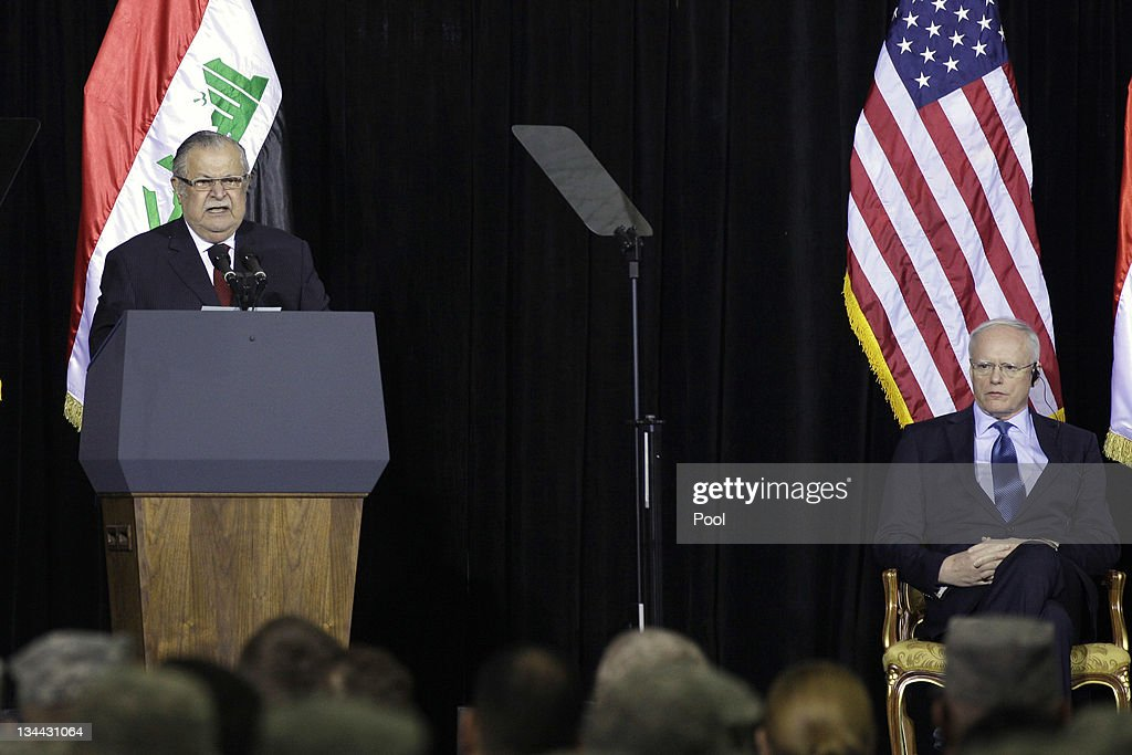 Iraqi President <a gi-track='captionPersonalityLinkClicked' href=/galleries/search?phrase=Jalal+Talabani&family=editorial&specificpeople=213582 ng-click='$event.stopPropagation()'>Jalal Talabani</a> (L) speaks as U.S. Ambassador to Iraq James Jeffrey listens during a special ceremony at Camp Victory, one of the last American bases in this country where the U.S. military footprint is swiftly shrinking, December 1, 2011 in Baghdad, Iraq. Vice President Joe Biden thanked U.S. and Iraqi troops for sacrifices that he said allowed for the end of the nearly nine-year-long war, even as attacks around the country killed 20 people, underscoring the security challenges Iraq still faces.
