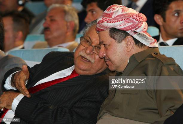 Iraqi President Jalal Talabani speaks with Kurdish regional president Massud Barzani during a ceremony to celebrate the start of oil export from the...