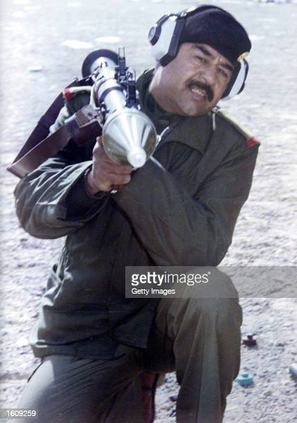 Iraqi President Saddam Hussein practices launching a rocked propelled grenade during the IraqIran war in an undated photo Hussein ordered August 13...