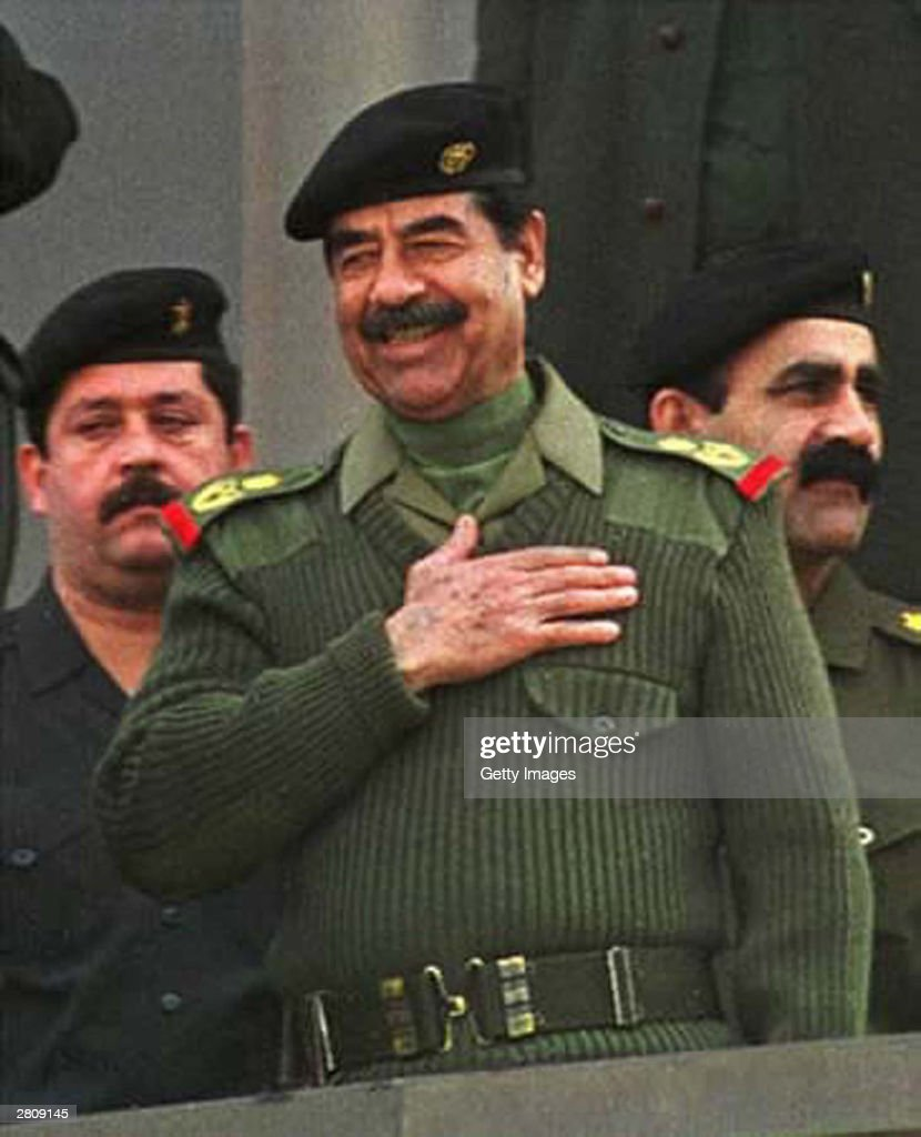 Iraqi President Saddam Hussein smiles January 1, 2001 while attending a military show in Baghdad, Iraq. The overthrown Iraqi dictator has been reportedly captured by US forces in his hometown of Tikrit December 13, 2003.