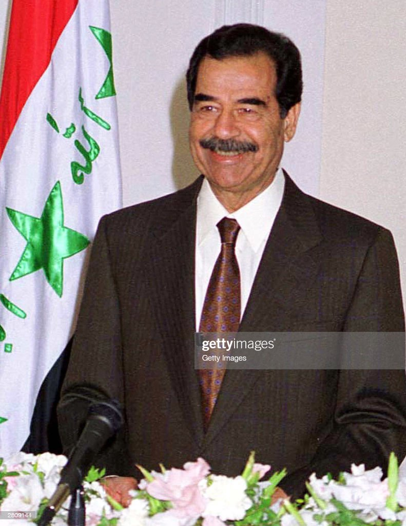 Iraqi President Saddam Hussein smiles January 6, 2001 as he delivers a national address in Baghdad, Iraq. The overthrown Iraqi dictator was reportedly captured by US troops in his hometown of Tikrit December 13, 2003.