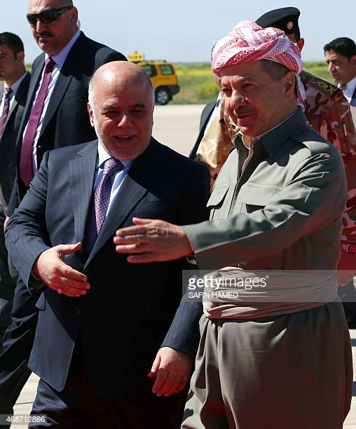 Iraqi Prime Minister Hadier alAbadi is welcomed by Iraqi Kurdish leader Massud Barzani following his arrival at the airport in Arbil the capital of...