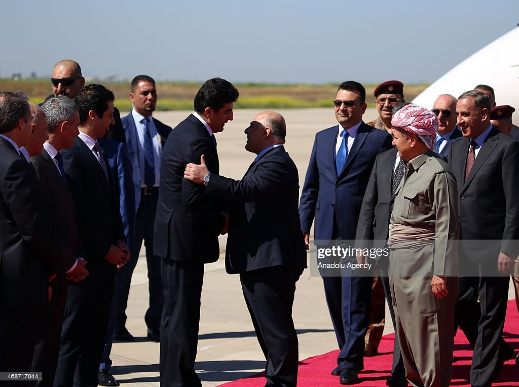Iraqi Prime Minister Haidar al-Abadi (C) is welcomed by Kurdistan Regional Government President Masoud Barzani (2nd R) and Prime Minister <a gi-track='captionPersonalityLinkClicked' href=/galleries/search?phrase=Nechirvan+Barzani&family=editorial&specificpeople=582951 ng-click='$event.stopPropagation()'>Nechirvan Barzani</a> (Center L) upon his arrival at Erbil International Airport on April 06, 2015 in Erbil.