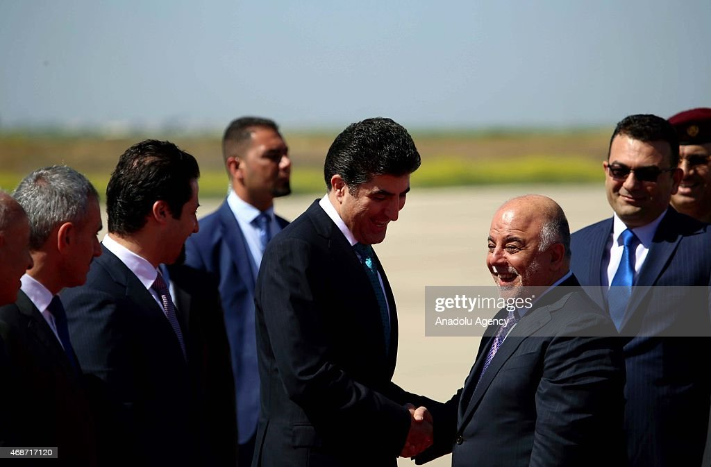 Iraqi Prime Minister Haidar al-Abadi (2nd R) is welcomed by Kurdistan Regional Government Prime Minister <a gi-track='captionPersonalityLinkClicked' href=/galleries/search?phrase=Nechirvan+Barzani&family=editorial&specificpeople=582951 ng-click='$event.stopPropagation()'>Nechirvan Barzani</a> (4th L) upon his arrival at Erbil International Airport on April 06, 2015 in Erbil.