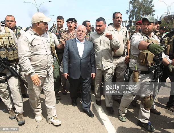 Iraqi Prime Minister Haidar alAbadi visits Tikrit on April 1 a day after he declared victory in the weekslong battle to retake the city from the...