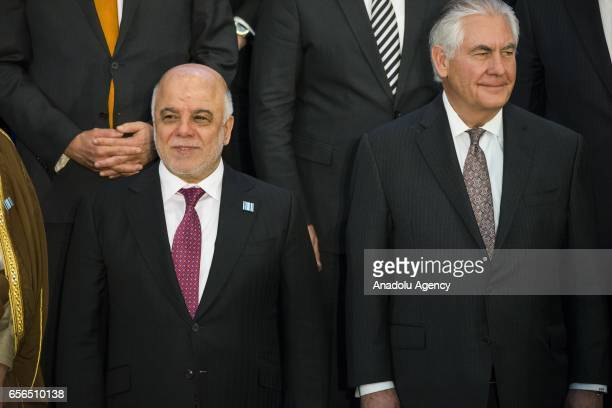 Iraqi Prime Minister Haider alAbadi and US Secretary of State Rex Tillerson are seen during the group photo session of the Meeting of Ministers of...