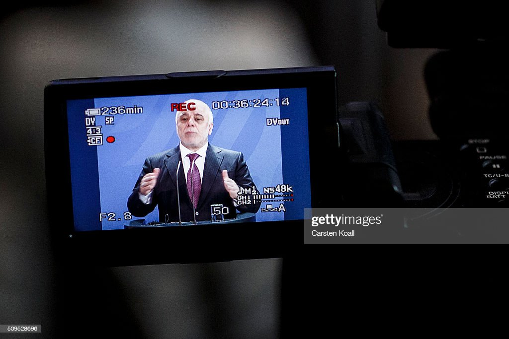 Iraqi Prime Minister Haider al-Abadi is seen on a display of a tv-camera during a press conference together with German Chancellor Angela Merkel to the media following talks at the Chancellery on February 11, 2016 in Berlin, Germany. The two leaders discussed, among other issues, the security situation in Iraq as well as the recent influx of large numbers of migrants and refugees from Iraq into Germany.