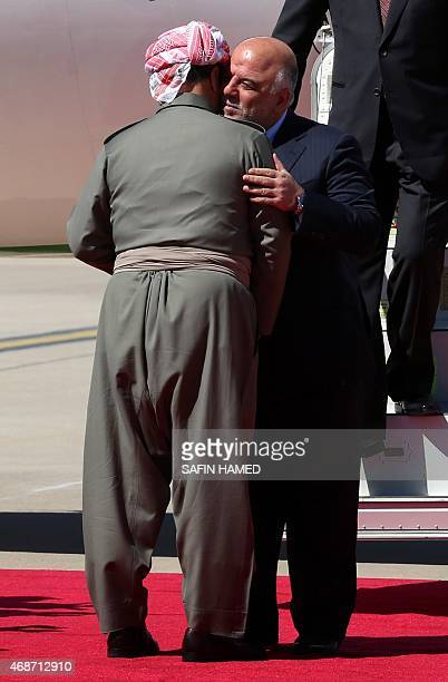 Iraqi Prime Minister Haider alAbadi is welcomed by Iraqi Kurdish leader Massud Barzani following his arrival at the airport in Arbil the capital of...