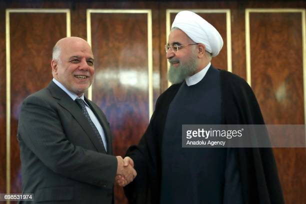 Iraqi Prime Minister Haider alAbadi meets with President of Iran Hassan Rouhani in Tehran Iran on June 20 2017