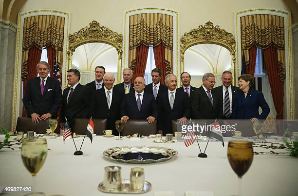 Iraqi Prime Minister Haider alAbadi poses for photographers with members of the US Senate Foreign Relations Committee Sen Edward Markey Sen Cory...