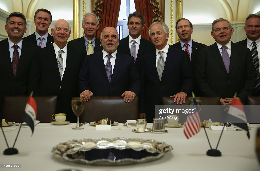 Iraqi Prime Minister Haider al-Abadi (5th L) poses for photographers with members of the U.S. Senate Foreign Relations Committee (L-R) Sen. <a gi-track='captionPersonalityLinkClicked' href=/galleries/search?phrase=Cory+Gardner&family=editorial&specificpeople=6977442 ng-click='$event.stopPropagation()'>Cory Gardner</a> (R-CO), Sen. <a gi-track='captionPersonalityLinkClicked' href=/galleries/search?phrase=David+Perdue&family=editorial&specificpeople=4276858 ng-click='$event.stopPropagation()'>David Perdue</a> (R-GA), ranking member Sen. Benjamin Cardin (D-MD), Sen. <a gi-track='captionPersonalityLinkClicked' href=/galleries/search?phrase=Ron+Johnson+-+Politician&family=editorial&specificpeople=12902569 ng-click='$event.stopPropagation()'>Ron Johnson</a> (R-WI), Sen. <a gi-track='captionPersonalityLinkClicked' href=/galleries/search?phrase=Jeff+Flake&family=editorial&specificpeople=2474871 ng-click='$event.stopPropagation()'>Jeff Flake</a> (R-AZ), chairman Sen. <a gi-track='captionPersonalityLinkClicked' href=/galleries/search?phrase=Bob+Corker&family=editorial&specificpeople=3986296 ng-click='$event.stopPropagation()'>Bob Corker</a> (R-TN), Sen. <a gi-track='captionPersonalityLinkClicked' href=/galleries/search?phrase=Tom+Udall&family=editorial&specificpeople=2796142 ng-click='$event.stopPropagation()'>Tom Udall</a> (D-NM), Sen. <a gi-track='captionPersonalityLinkClicked' href=/galleries/search?phrase=Robert+Menendez&family=editorial&specificpeople=504931 ng-click='$event.stopPropagation()'>Robert Menendez</a> (D-NJ) and Sen. Tim Kaine (D-VA) prior to a meeting April 15, 2015 on Capitol Hill in Washington, DC. Prime Minister al-Abadi is on a visit in Washington, DC.