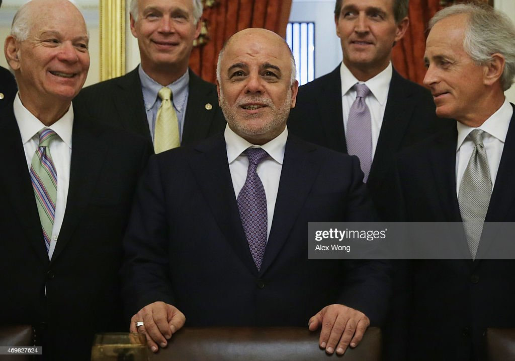 Iraqi Prime Minister Haider al-Abadi (3rd L) poses for photographers with members of the U.S. Senate Foreign Relations Committee (L-R) ranking member Sen. Benjamin Cardin (D-MD), Sen. <a gi-track='captionPersonalityLinkClicked' href=/galleries/search?phrase=Ron+Johnson+-+Politician&family=editorial&specificpeople=12902569 ng-click='$event.stopPropagation()'>Ron Johnson</a> (R-WI), Sen. <a gi-track='captionPersonalityLinkClicked' href=/galleries/search?phrase=Jeff+Flake&family=editorial&specificpeople=2474871 ng-click='$event.stopPropagation()'>Jeff Flake</a> (R-AZ) and chairman Sen. <a gi-track='captionPersonalityLinkClicked' href=/galleries/search?phrase=Bob+Corker&family=editorial&specificpeople=3986296 ng-click='$event.stopPropagation()'>Bob Corker</a> (R-TN) prior to a meeting April 15, 2015 on Capitol Hill in Washington, DC. Prime Minister al-Abadi is on a visit in Washington, DC.