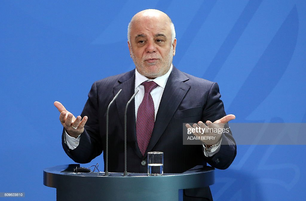 Iraqi Prime Minister Haider al-Abadi speaks at a joint press conference with German Chancellor after their meeting at the Chancellery in Berlin on February 11, 2016. Al-Abadi met with German Chancellor Angela Merkel. / AFP / Adam BERRY