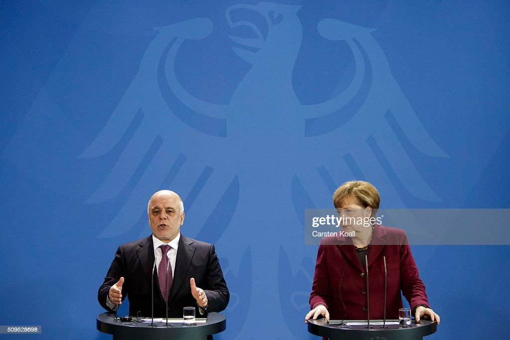 Iraqi Prime Minister Haider al-Abadi (L) speaks during a press conference together with German Chancellor <a gi-track='captionPersonalityLinkClicked' href=/galleries/search?phrase=Angela+Merkel&family=editorial&specificpeople=202161 ng-click='$event.stopPropagation()'>Angela Merkel</a> to the media following talks at the Chancellery on February 11, 2016 in Berlin, Germany. The two leaders discussed, among other issues, the security situation in Iraq as well as the recent influx of large numbers of migrants and refugees from Iraq into Germany.
