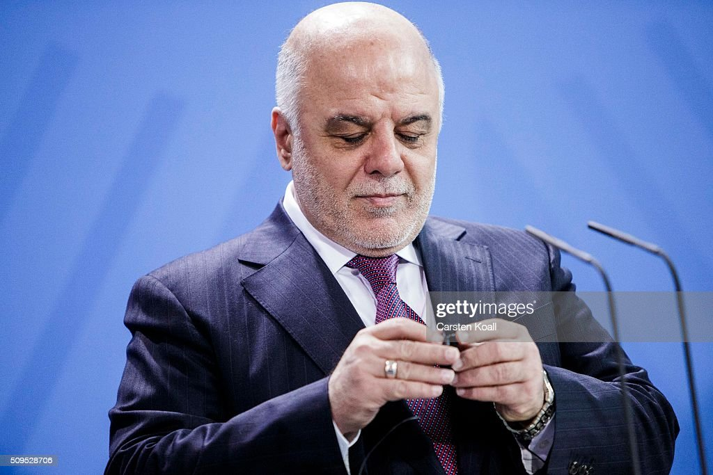 Iraqi Prime Minister Haider al-Abadi speaks during a press conference together with German Chancellor Angela Merkel to the media following talks at the Chancellery on February 11, 2016 in Berlin, Germany. The two leaders discussed, among other issues, the security situation in Iraq as well as the recent influx of large numbers of migrants and refugees from Iraq into Germany.
