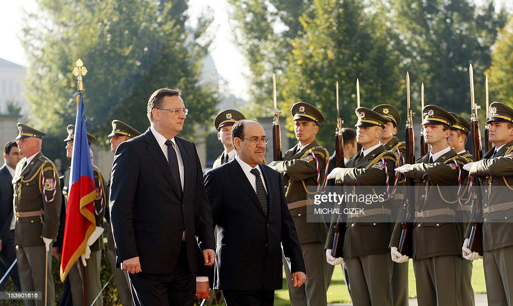 Iraqi Prime Minister Nouri al-Maliki (R) and Czech Prime Minister Petr Necas review a guard of honour during a welcoming ceremony at the government headquarter on October 11, 2012 in Prague.