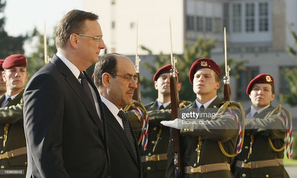 Iraqi Prime Minister Nouri al-Maliki (R) and Czech Prime Minister Petr Necas (L) review a guard of honour during a welcoming ceremony at the government headquarter on October 11, 2012 in Prague.