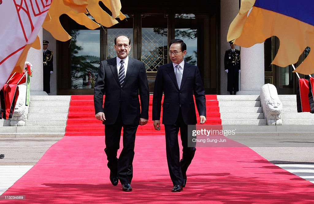 Iraqi Prime Minister Nouri al-Maliki (L) and South Korean President <a gi-track='captionPersonalityLinkClicked' href=/galleries/search?phrase=Lee+Myung-Bak&family=editorial&specificpeople=704274 ng-click='$event.stopPropagation()'>Lee Myung-Bak</a> walk towards a guard of honour during a welcoming ceremony held at the presidential Blue House on April 28, 2011 in Seoul, South Korea. Iraq and South Korea met to discuss economic exchanges and to strengthen bilateral relationships in trade, culture and diplomacy.
