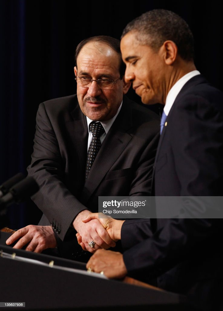 Iraqi Prime Minister Nouri Al-Maliki (L) and U.S. President <a gi-track='captionPersonalityLinkClicked' href=/galleries/search?phrase=Barack+Obama&family=editorial&specificpeople=203260 ng-click='$event.stopPropagation()'>Barack Obama</a> shake hands during a news conference in the Eisenhower Executive Office Building next to the White House December 12, 2011 in Washington, DC. Al-Maliki is in Washington for talks ahead of the December 31 full withdrawal of U.S. troops from Iraq and the end of a deeply divisive nine-year war.