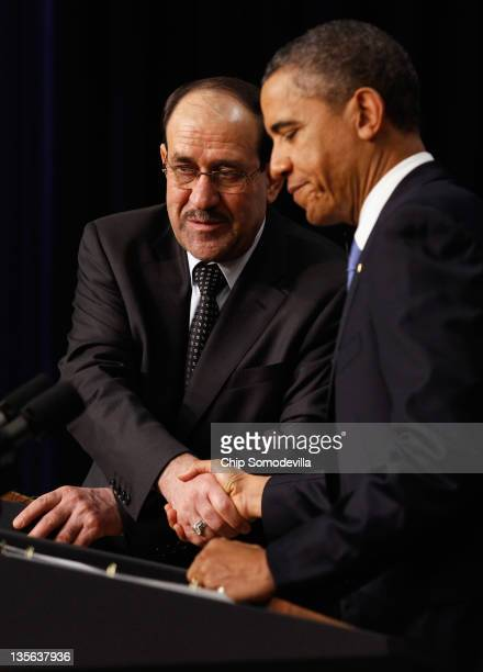 Iraqi Prime Minister Nouri AlMaliki and US President Barack Obama shake hands during a news conference in the Eisenhower Executive Office Building...