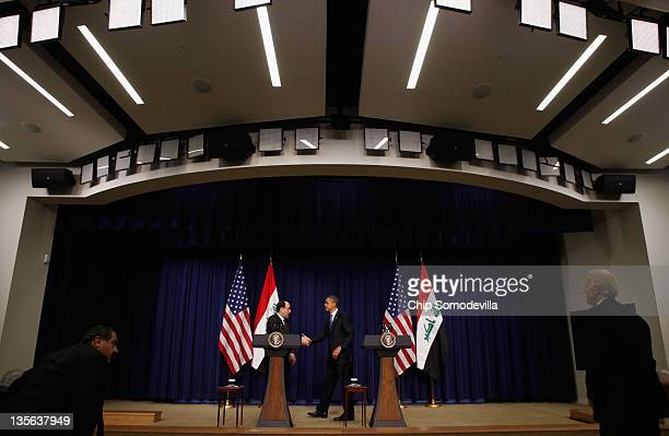 Iraqi Prime Minister Nouri AlMaliki and US President Barack Obama shake hands after a news conference in the Eisenhower Executive Office Building...