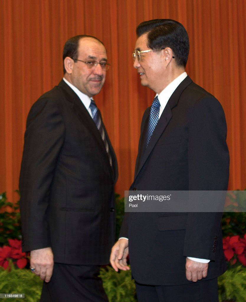 Iraqi Prime Minister <a gi-track='captionPersonalityLinkClicked' href=/galleries/search?phrase=Nouri+al-Maliki&family=editorial&specificpeople=539622 ng-click='$event.stopPropagation()'>Nouri al-Maliki</a>, left, meets with Chinese President <a gi-track='captionPersonalityLinkClicked' href=/galleries/search?phrase=Hu+Jintao&family=editorial&specificpeople=203109 ng-click='$event.stopPropagation()'>Hu Jintao</a> ahead of a bilateral meeting at the Great Hall of the People on July 19, 2011 in Beijing, China. Maliki is visiting China to have high-level talks aimed at securing investment in the reconstruction of the war-ravaged nation.