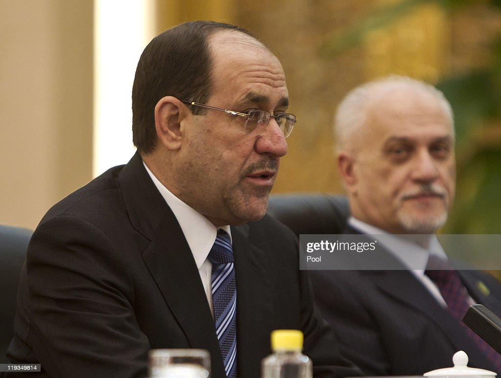 Iraqi Prime Minister <a gi-track='captionPersonalityLinkClicked' href=/galleries/search?phrase=Nouri+al-Maliki&family=editorial&specificpeople=539622 ng-click='$event.stopPropagation()'>Nouri al-Maliki</a>, left, speaks during a bilateral meeting with Chinese President Hu Jintao at the Great Hall of the People on July 19, 2011 in Beijing, China. Maliki is visiting China to have high-level talks aimed at securing investment in the reconstruction of the war-ravaged nation.