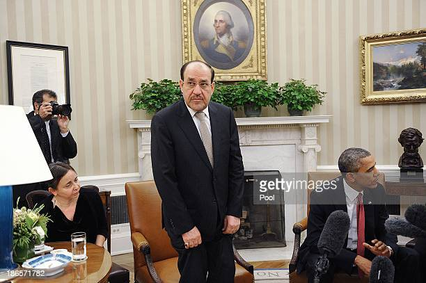 Iraqi Prime Minister Nouri AlMaliki looks on after a meeting US President Barack Obama in the Oval Office at the White House November 1 2013 in...