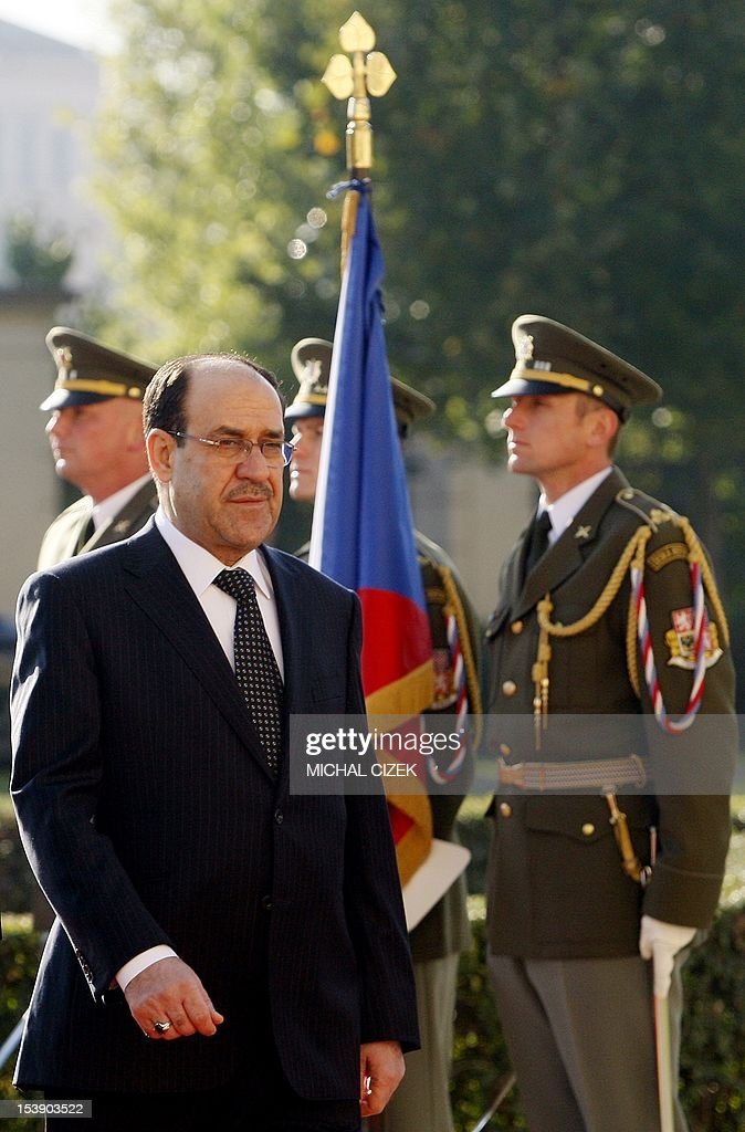 Iraqi Prime Minister Nouri al-Maliki reviews a guard of honour during a welcoming ceremony at the government headquarter on October 11, 2012 in Prague. Czech Prime Minister Petr Necas welecomed the Iraqi leader to the Czech capital. AFP PHOTO / MICHAL CIZEK