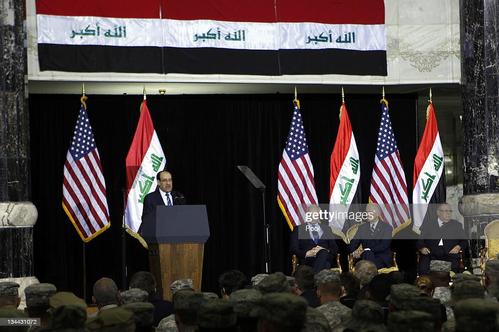 Iraqi Prime Minister <a gi-track='captionPersonalityLinkClicked' href=/galleries/search?phrase=Nouri+al-Maliki&family=editorial&specificpeople=539622 ng-click='$event.stopPropagation()'>Nouri al-Maliki</a> (L) speaks as Iraqi President <a gi-track='captionPersonalityLinkClicked' href=/galleries/search?phrase=Jalal+Talabani&family=editorial&specificpeople=213582 ng-click='$event.stopPropagation()'>Jalal Talabani</a> (R), U.S. Vice President Joe Biden (2R), U.S. Ambassador to Iraq James Jeffrey, and U.S. soldiers attend a special ceremony at Camp Victory, one of the last American bases in this country where the U.S. military footprint is swiftly shrinking, December 1, 2011 in Baghdad, Iraq. Vice President Joe Biden thanked U.S. and Iraqi troops for sacrifices that he said allowed for the end of the nearly nine-year-long war, even as attacks around the country killed 20 people, underscoring the security challenges Iraq still faces.