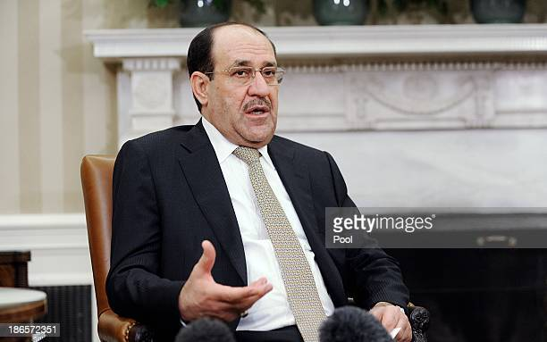 Iraqi Prime Minister Nouri AlMaliki speaks during a meeting with US President Barack Obama in the Oval Office at the White House November 1 2013 in...
