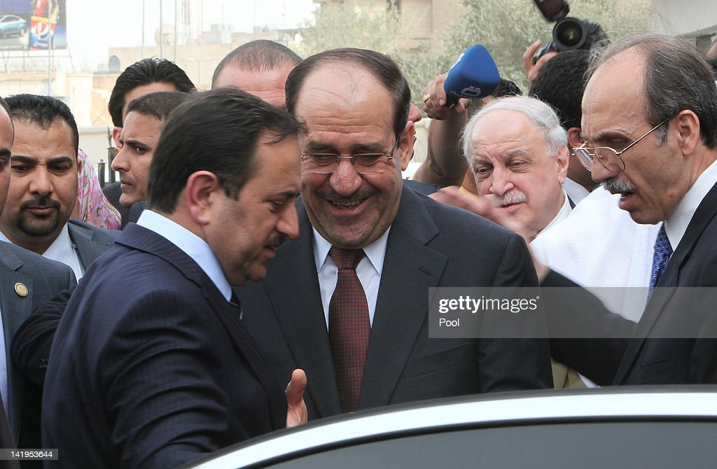 Iraqi prime Minister Nuri al-Maliki (C) leaves after attending the Arab economy, finance and trade ministers meeting as part of Arab League Summit at Ishtar Sheraton Hotel on March 27, 2012 in Baghdad, Iraq. The Arab leaders will meet in Baghdad for the 23rd regular session of Arab summit on March 29.