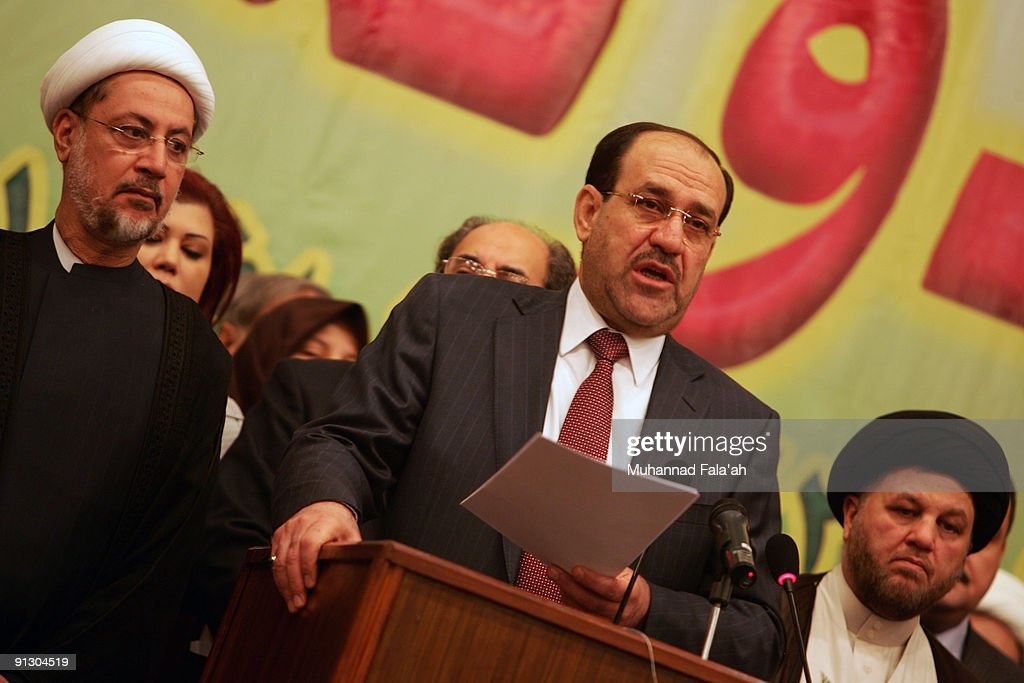 Iraqi Prime Minister Nuri al-Maliki reads a speech during a meeting for his 'State of Law Coalition', a political alliance for the upcoming Iraqi elections, on October 1, 2009 in Baghdad, Iraq. Al-Maliki's Shiite-led coalition joins with Sunni parties and clans from around the country in preparation for the January 16 vote. A coalition of 40 different groups it also includes some Kurdish and Christian parties from the north of the country. Al-Maliki rejected joining a Shiite faction coalition and put together a rival movement which places emphasis on secular policies and reconciliation with Sunnis after years of sectarian bloodshed.