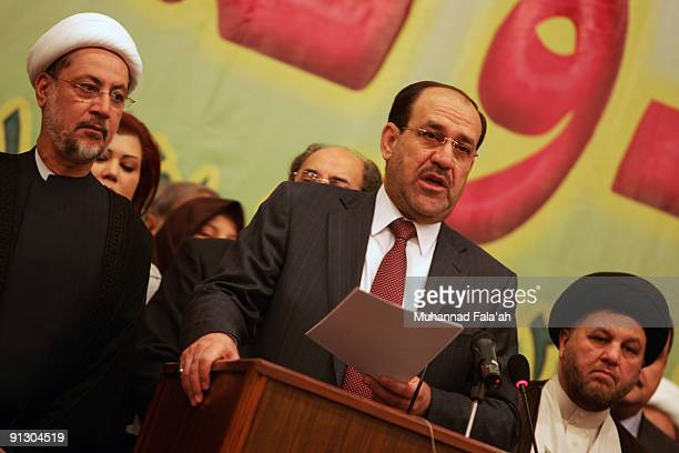 Iraqi Prime Minister Nuri alMaliki reads a speech during a meeting for his 'State of Law Coalition' a political alliance for the upcoming Iraqi...
