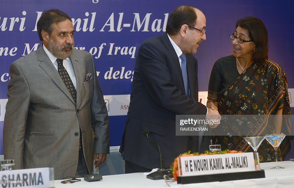 Iraqi Prime Minister Nuri al-Maliki (C) shakes hands with Federation of Indian Chambers of Commerce and Industry (FICCI) President Naina Lal Kidwai (R) as Indian Minister for Commerce and Industry Anand Sharma (R) looks on during a business meeting in New Delhi on August 23, 2013. Iraqi Prime Minister Nuri al-Maliki is in India to push for investment in much-needed reconstruction, as New Delhi looks to secure critical energy supplies.