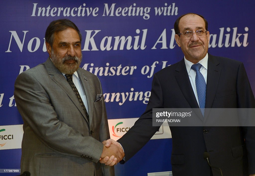 Iraqi Prime Minister Nuri al-Maliki (R) shakes hands with Indian Minister for Commerce and Industry Anand Sharma during a business meeting in New Delhi on August 23, 2013. Iraqi Prime Minister Nuri al-Maliki is in India to push for investment in much-needed reconstruction, as New Delhi looks to secure critical energy supplies. AFP PHOTO/RAVEENDRAN