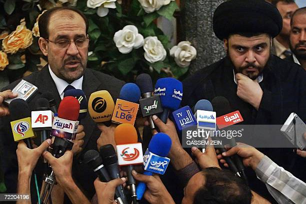 Iraqi Prime Minister Nuri alMaliki speaks during a joint press conference with Shiite firebrand cleric Moqtada alSadr upon their meeting in the holy...