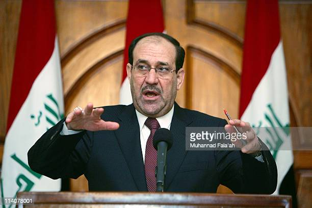 Iraqi Prime Minister Nuri alMaliki speaks during a press conference on May 11 2011 at the green zone area in Baghdad Iraq AlMaliki has suggested that...