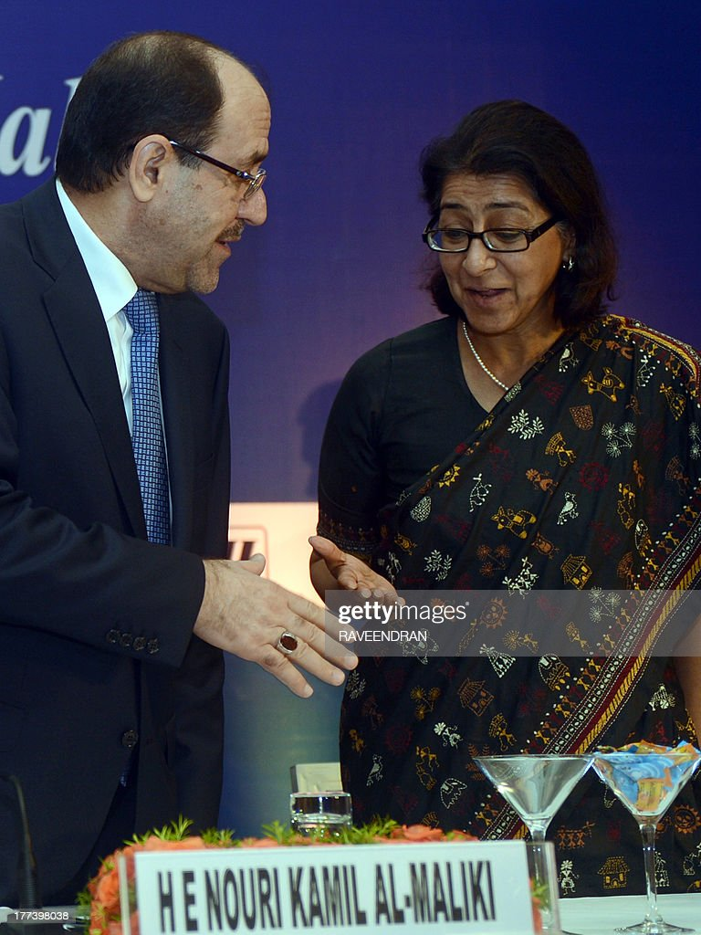 Iraqi Prime Minister Nuri al-Maliki (L) talks with Federation of Indian Chambers of Commerce and Industry (FICCI) President Naina Lal Kidwai during a business meeting in New Delhi on August 23, 2013. Iraqi Prime Minister Nuri al-Maliki is in India to push for investment in much-needed reconstruction, as New Delhi looks to secure critical energy supplies.