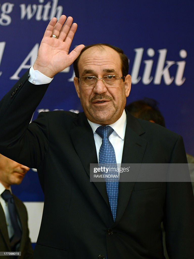 Iraqi Prime Minister Nuri al-Maliki waves to delegates as he arrives for a business meeting in New Delhi on August 23, 2013. Iraqi Prime Minister Nuri al-Maliki is in India to push for investment in much-needed reconstruction, as New Delhi looks to secure critical energy supplies. AFP PHOTO/RAVEENDRAN