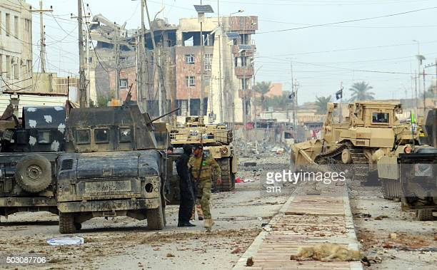 Iraqi progovernment forces battle Islamic State group jihadists as they try to secure all the neighbourhoods of Ramadi the capital of Iraq's Anbar...