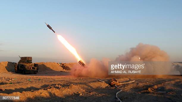 TOPSHOT Iraqi progovernment forces fire a rocket during clashes with Islamic State group fighters on the eastern outskirts of Ramadi the capital of...