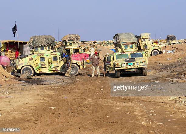 Iraqi progovernment tribal forces hold a position in the Tel Mushaihed area east of Ramadi a large city on the Euphrates 100 kilometres west of...
