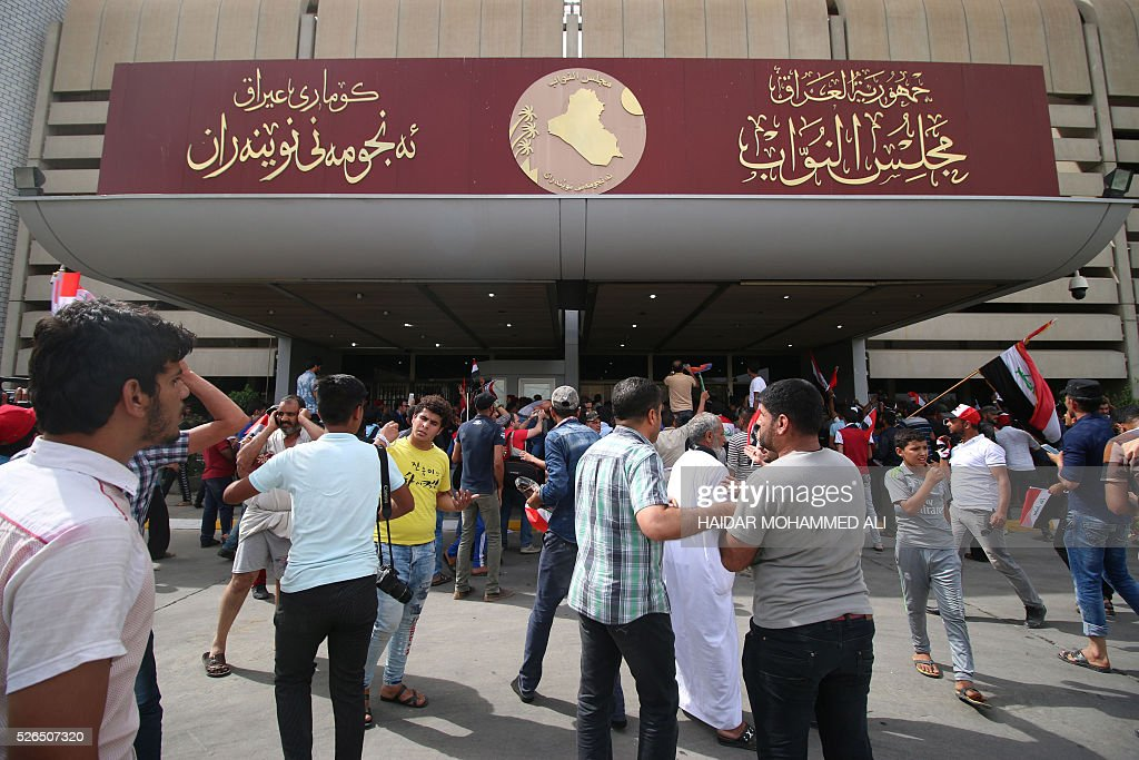 Iraqi protesters enter the parliament after braking into Baghdad's heavily fortified 'Green Zone' on April 30, 2016. A protest held outside the Green Zone escalated after parliament again failed to reach a quorum and approve new ministers to replace the current government of party-affiliated ministers. / AFP / HAIDAR