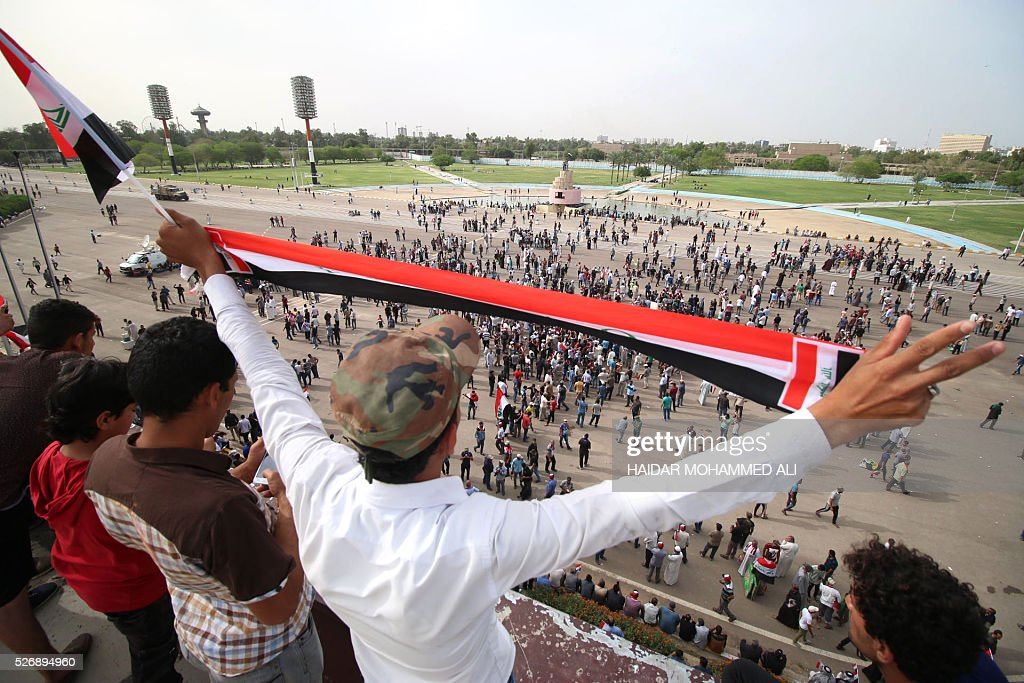 Iraqi protesters gather in the parade grounds outside the parliament in Baghdad's heavily fortified 'Green Zone' on May 1, 2016, a day after supporters of Shiite cleric Moqtada al-Sadr broke into the area after lawmakers again failed to approve new ministers. Protesters were withdrawing from Baghdad's Green Zone after breaking into the fortified area and storming Iraq's parliament in an unprecedented security breach the day before. The move, which lessens the pressure on politicians in Baghdad, came as rare bombings in the south killed 33 people and wounded dozens. / AFP / HAIDAR